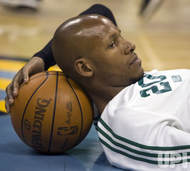 Celtics Allen Watches Warm Ups in Denver