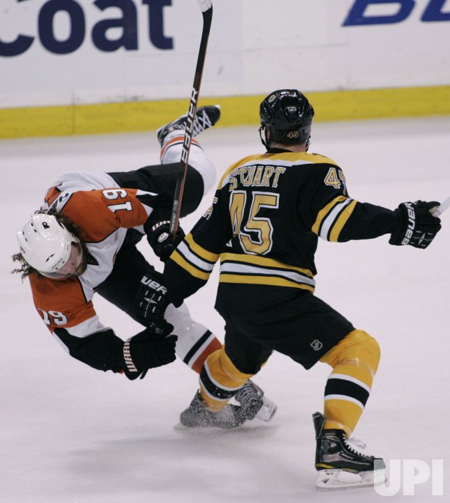 Bruins Stuart checks Flyers Hartnell in Game 7 of the NHL Eastern Conference Semi-Final in Boston, MA.