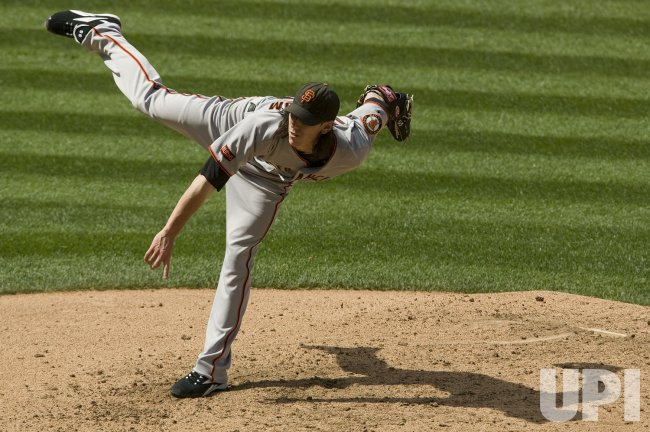 Giants Lincecum Pitches in Denver
