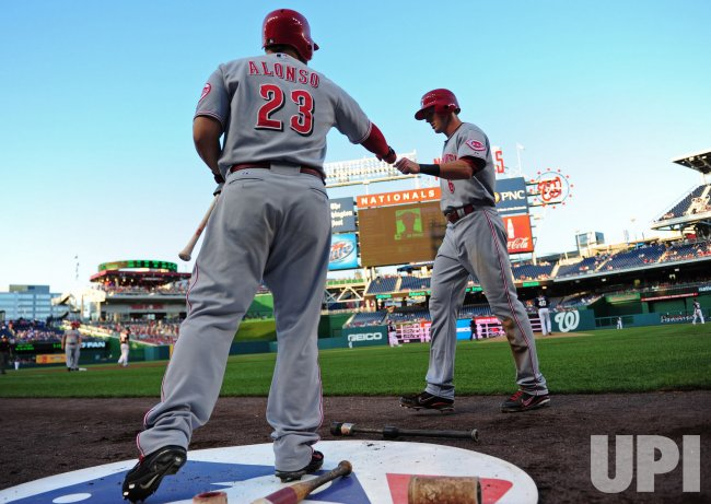 Reds' Drew Stubbs is congratulated by teammate Yonder Alonso in Washington