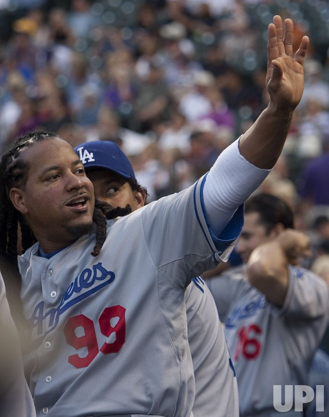 Dodgers Ramirez Waves to Fans in Denver