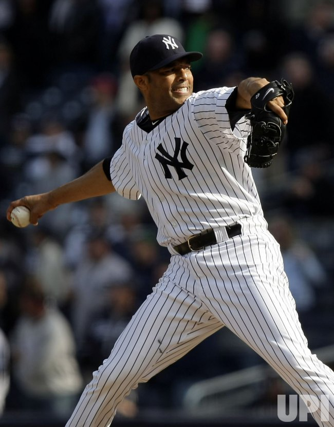 New York Yankees closer Mariano Rivera throws a pitch on opening day at Yankee Stadium in New York