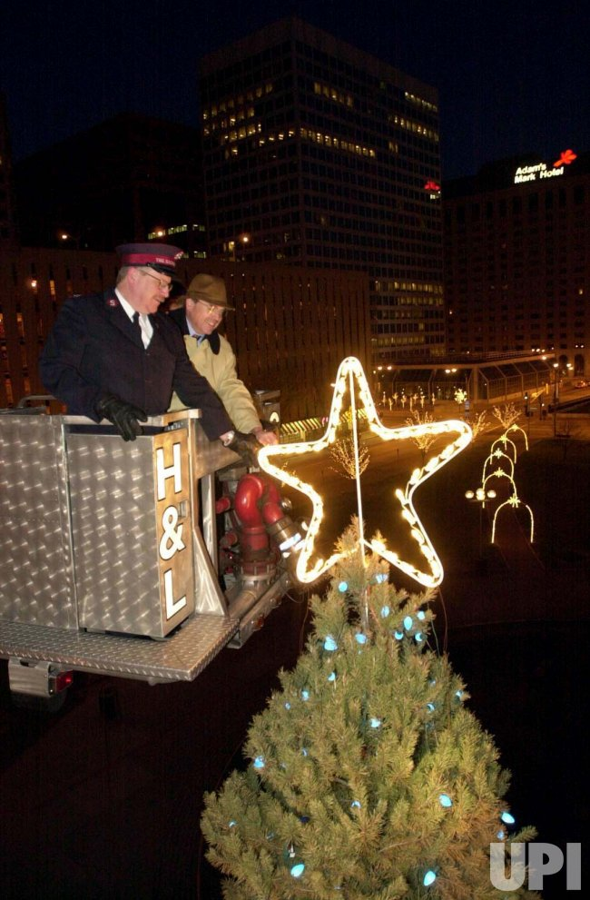 The Salvation Army lights star atop tree