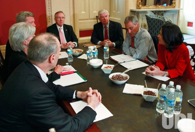 Rahm Emanuel meets with Senators Reid, Baucus, Dodd and other members of the Administration on Capitol Hill in Washington
