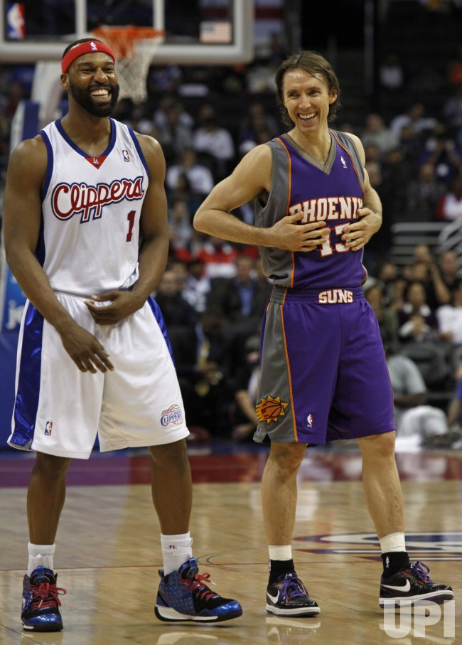 Clippers Baron Davis and Suns Steve Nash share a laugh in Los Angeles