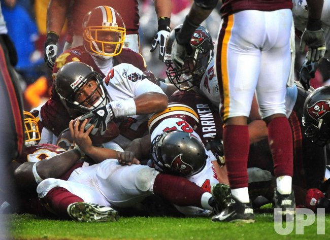 Buccaneers' quarterback Josh Freeman rushes for a two point conversion in Maryland