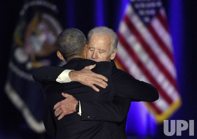 U.S. President Obama hugs Vice President Biden after farewell speech in Chicago