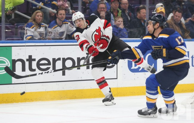 New Jersey Devils Ben Lovejoy clears the puck away from his zone