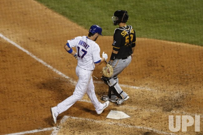 Cubs Kris Bryant Scores at Wrigley Field in Chicago