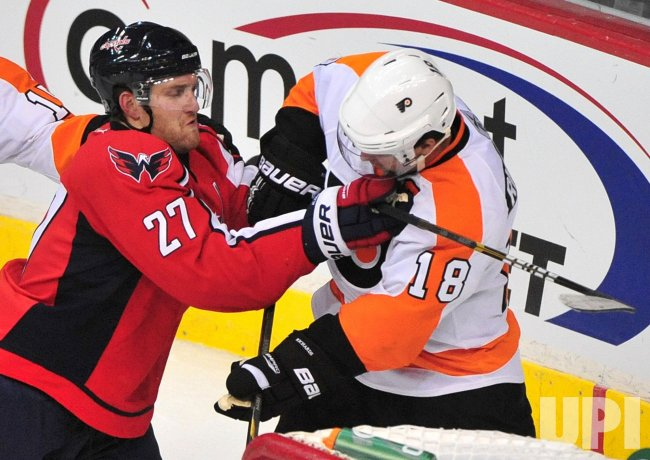 Capitals' Karl Alzner cross checks Philadelphia Flyers' Mike Richards in Washington