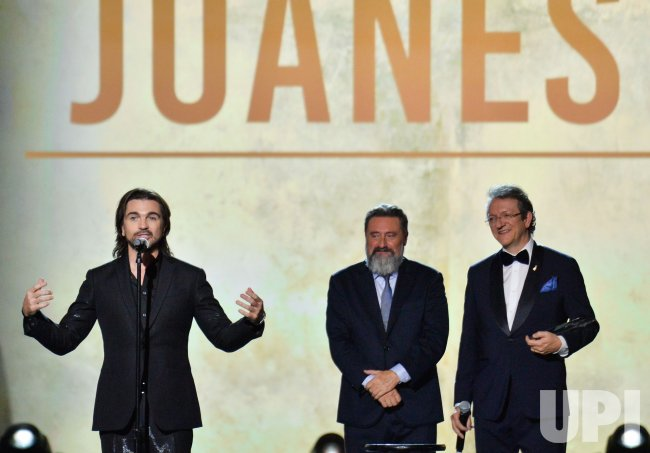 Juanes, Jesus Lopez and Gabriel Abaroa onstage at Person of the Year gala in Las Vegas