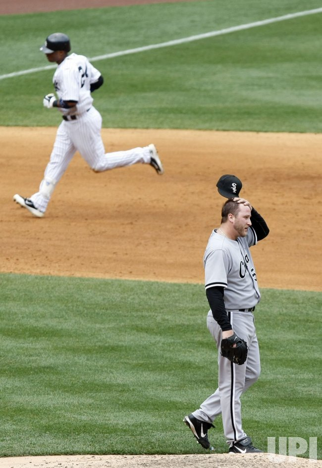 Chicago White Sox starting pitcher Mark Buehrle reacts as New York Yankees Robinson Cano runs the bases at Yankee Stadium in New York