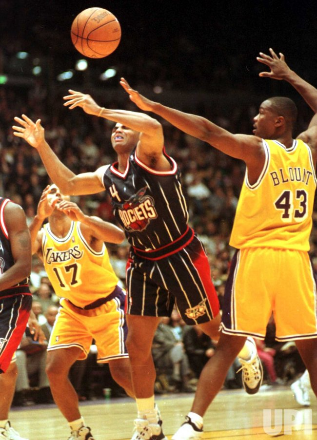 Houston Rockets forward Charles Barkley(#4) loses the ball