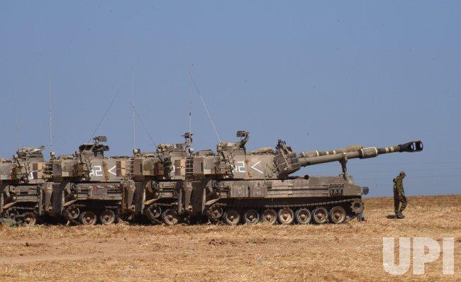 An Israeli Soldier Walks In Near Artillery Batteries On The Israel-Gaza Border