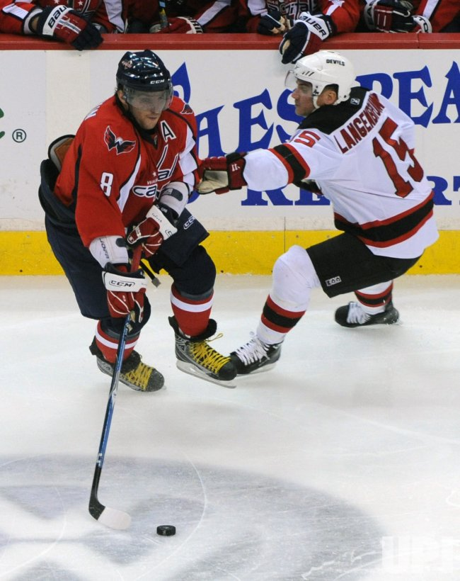 Capitals Ovechkin handles puck against the Devils in Washington