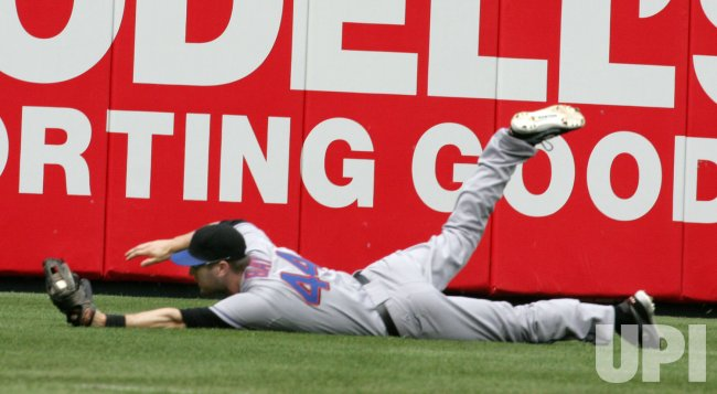 Mets left fielder catches fly by Placido Polanco in the first