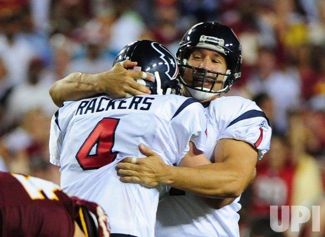 Houston Texans' kicker Neil Rackers celebrates in Washington