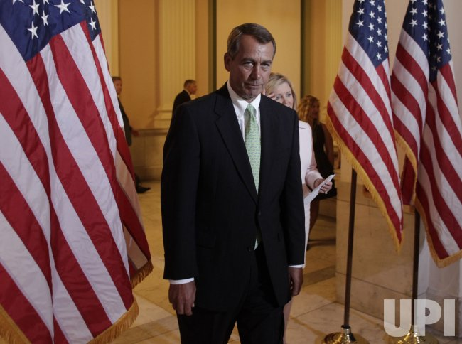House Minority Leader John Boehner talks to reporters