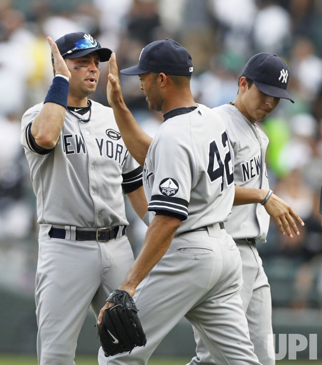 Yankees Swisher, Rivera and Pena celebrate win over White Sox in Chicago