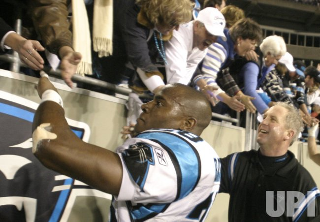 CHP2004010313 JOHN FOX CELEBRATES WITH CAROLINA PANTHER FAN AFTER VICTORY