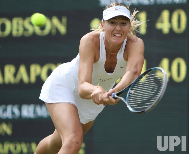 Maria Sharapova returns at Wimbledon.