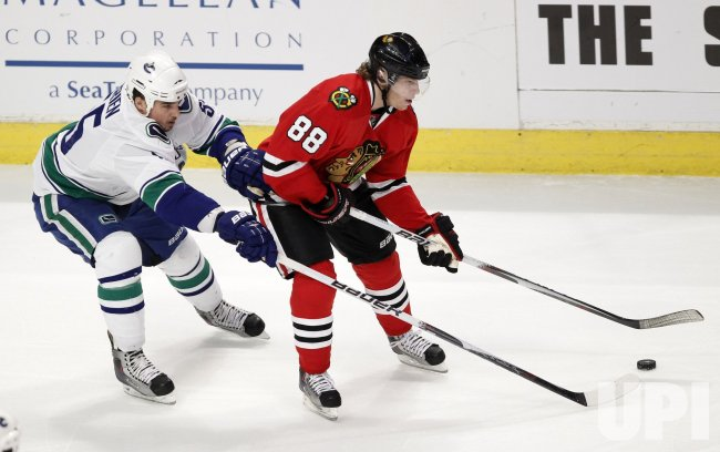 Canucks O'Brein chases Blackhawks Kane in Chicago