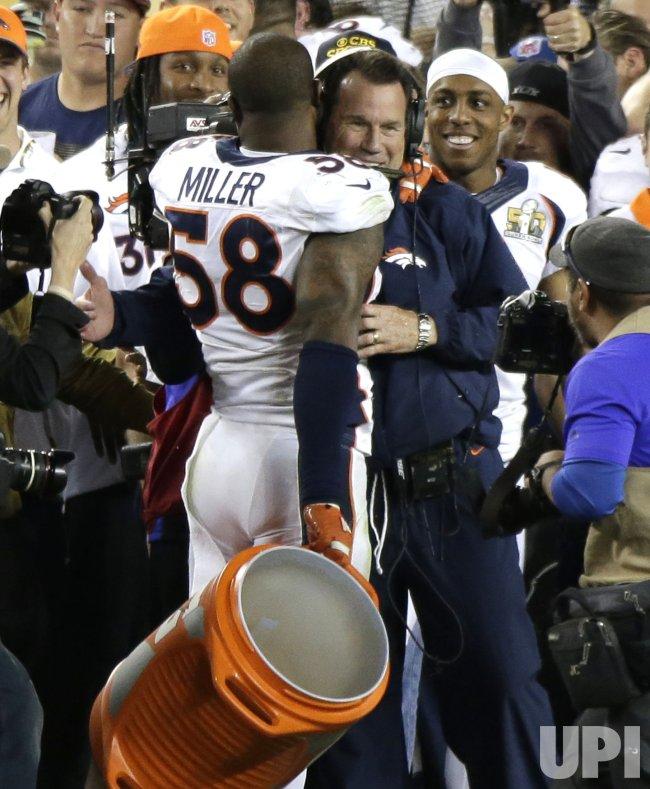 Denver Broncos Von Miller smiles with coach Gary Kubiak
