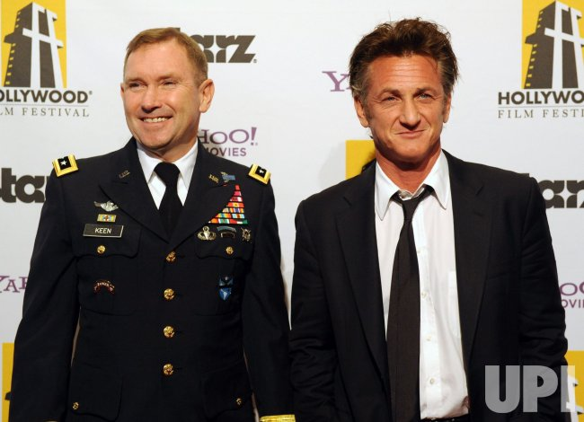 Sean Penn and Lt. Gen. Ken Keen attend the 14th annual Hollywood Film Festival Awards in Beverly Hills, California