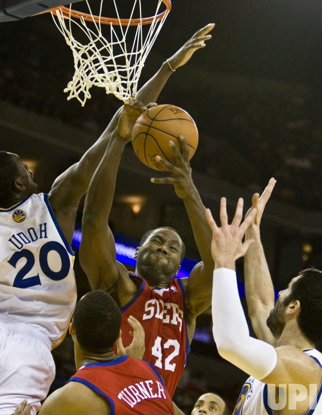 76ers Elton Brand has his shot blocked by Golden State Warriors Ekpe Udoh in Oakland, California