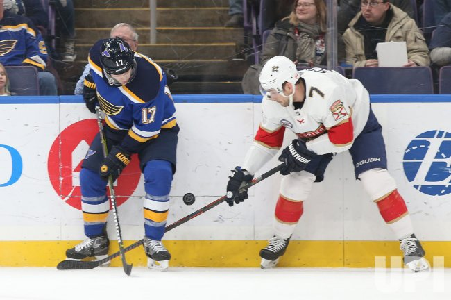St. Louis Blues Jaden Schwartz and Florida Panthers Colton Sceviour fight for puck