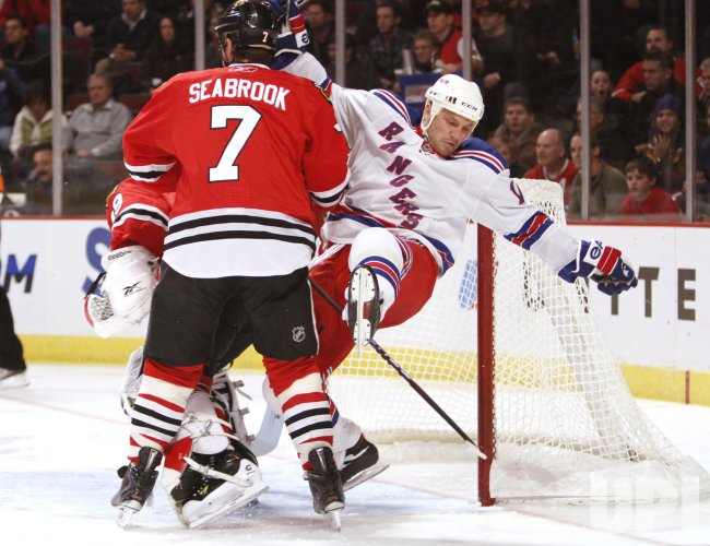 Blackhawks' Seabrook checks Rangers' Avery in Chicago