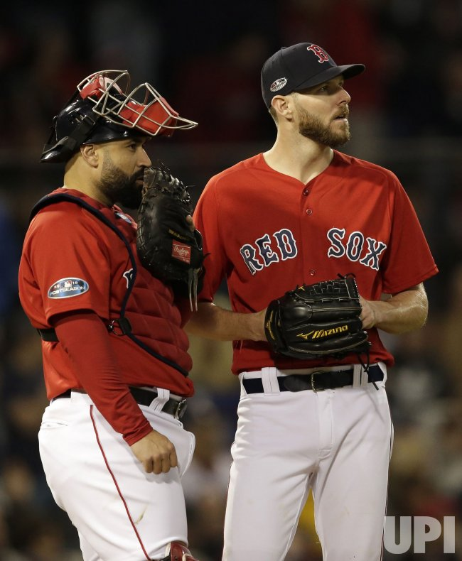 Red Sox Chris Sale, Sandy Leon during ALCS Game 1 in Boston