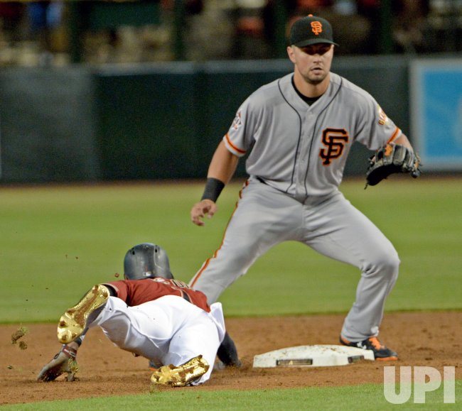 Giants' Panik waits for throw from pitcher Holland