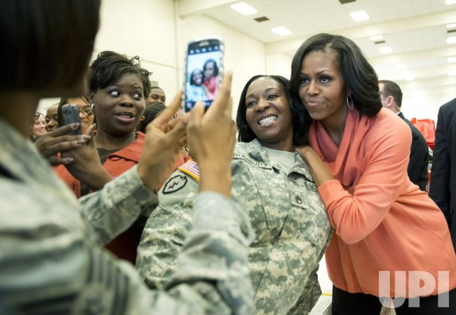 First Lady Michelle Obama helps sort gifts for Toys for Tots in Washington
