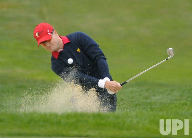 Zach Johnson hits from a bunker during the final round of the 2009 Presidents Cup in San Francisco