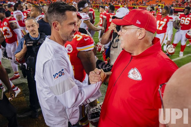 Chiefs Andy Reid and 49ers Kyle Shanahan greet each other at midfield