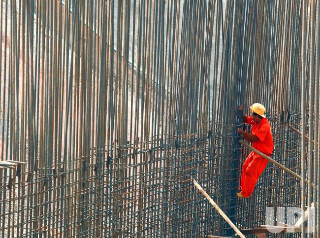 A construction worker ties steel rebars in Shenzhen