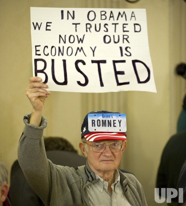 Romney supporter holds up sign at rally in Des Moines, Iowa
