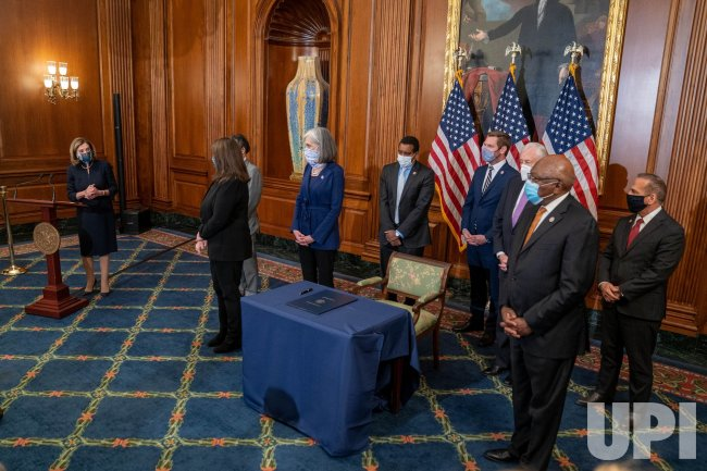Pelosi Signs Article of Impeachment