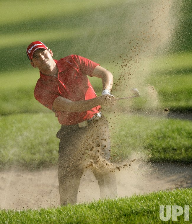 Sergio Garcia blasts out of a bunker on the 11th hole during the first round of the 91st PGA Championship in Chaska, Minnesota