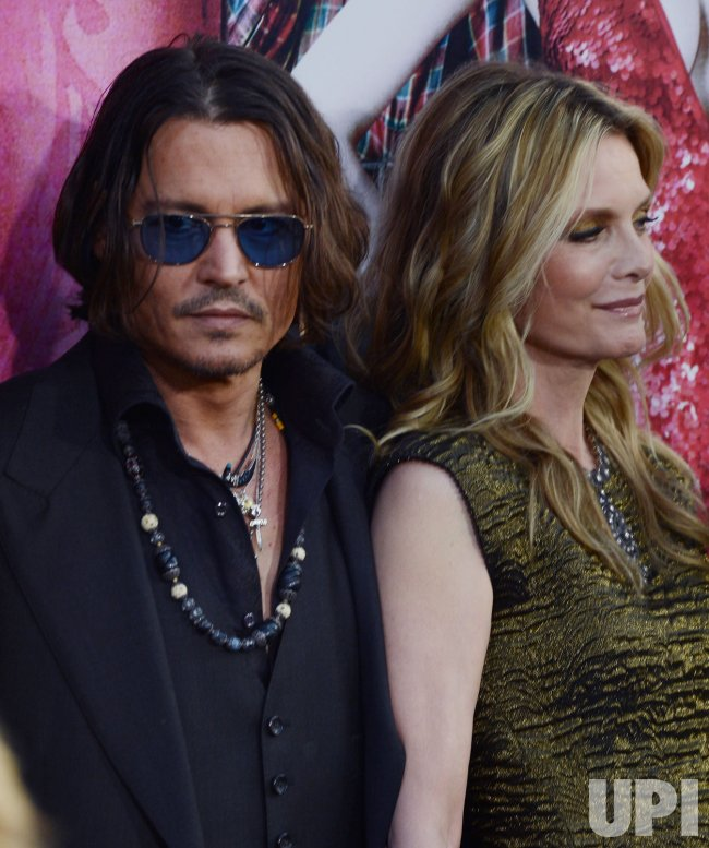 "Johnny Depp and Michelle Pfeiffer attend the ""Dark Shadows"" premiere in Los Angeles"