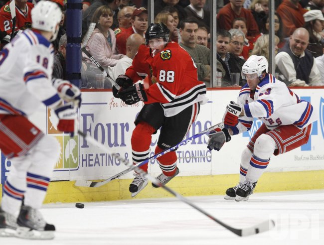 Blackhawks' Kane skates past Rangers' Drury in Chicago