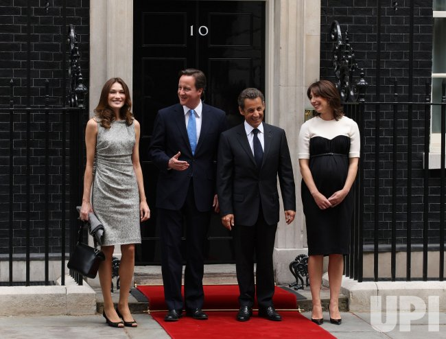 David Cameron and wife Samantha pose with Nicolas Sarkozy and wife Carla Bruni pose at No.10 Downing St.