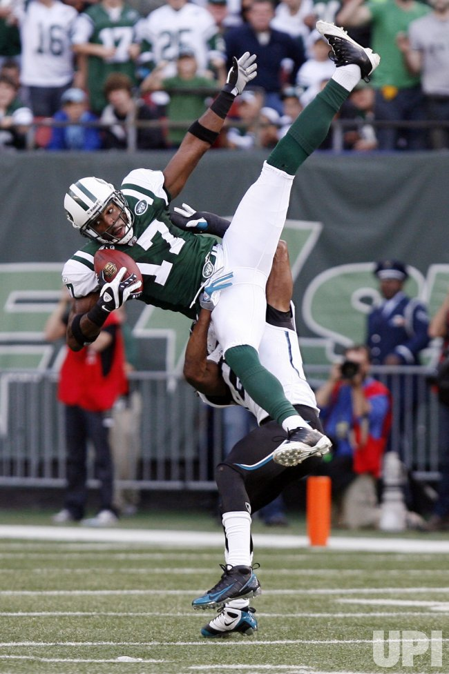 New York Jets Braylon Edwards is pulled to the ground by Jacksonville Jaguars Rashean Mathis after Edwards makes a 16 yard reception in the fourth quarter of week 10 of the NFL season at Giants Stadium