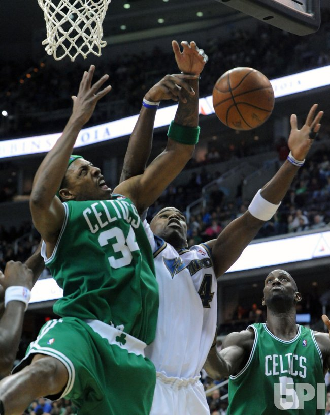 Wizards Jamison and Celtics Pierce go for a rebound in Washington