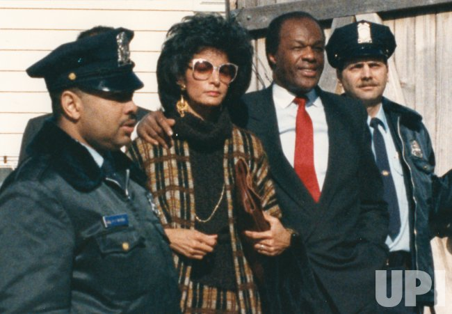 DC Mayor Marion Barry and wife Effie escorted by police to U.S. District Court