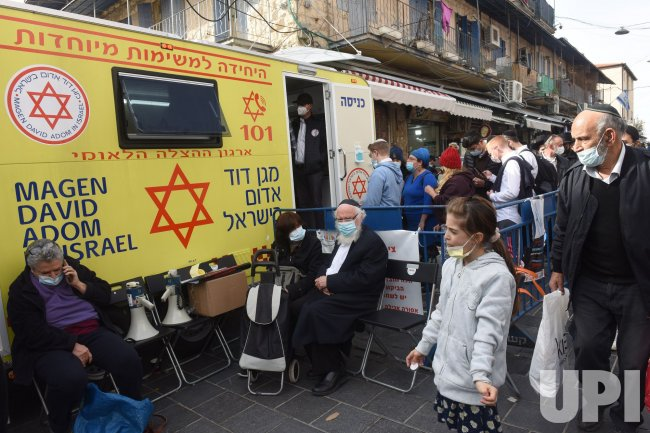 Israeli Wait To Receive The Pfizer-Biotech Coronavirus Vaccine In A MDA Mobile Clinic In Jerusalem