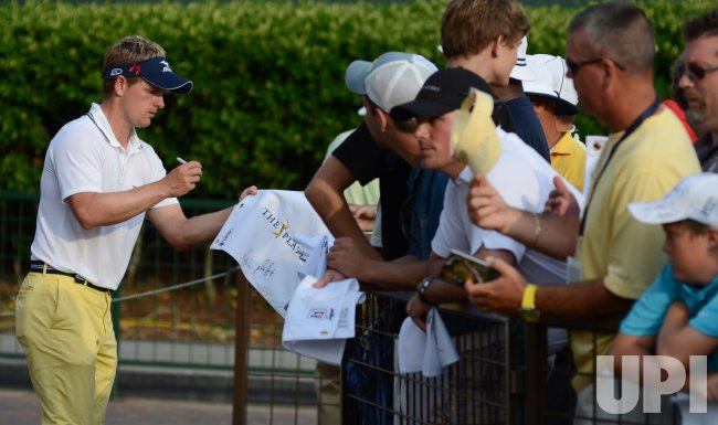 Luke Donald signs autographs during the TPC Players in Florida
