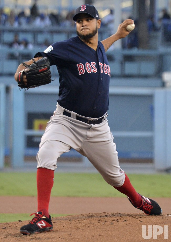 Red Sox starter Rodriguez throws against the Dodgers during the first inning in Game 4 of the World Series