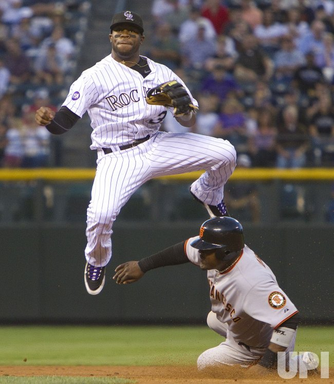 Rockies Young Forces Giants Uribe in Denver